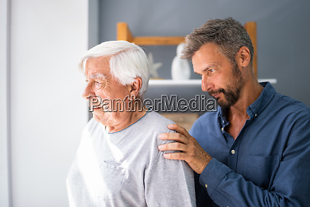 old senior man with dementia getting