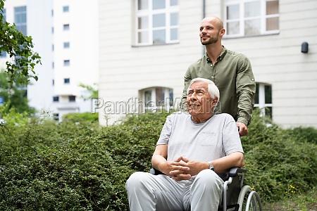 old smiling senior wheelchair transport