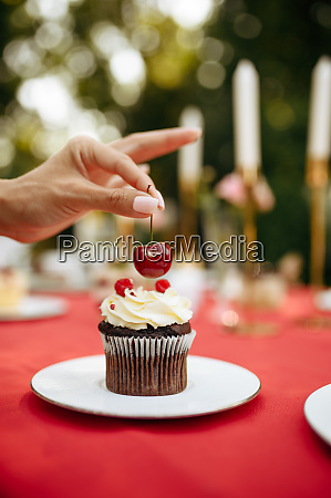 table setting woman decorate cake with