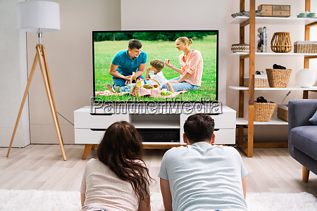 happy family watching tv or film