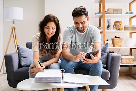happy family using calculator for tax