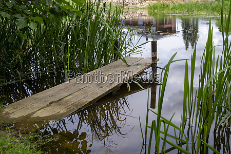 old rustic wooden jetty on a