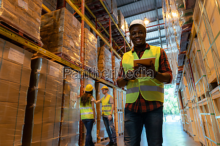 black supervisor warehouse manager with digital