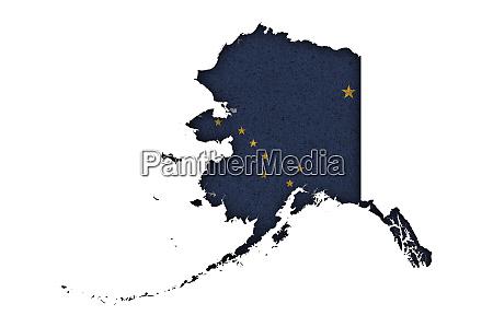 map and flag of alaska on