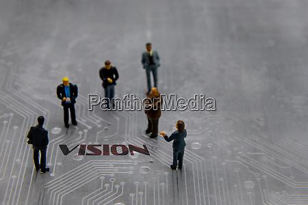miniature figurines posed as business people