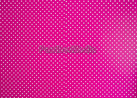 pink background texture with white polka