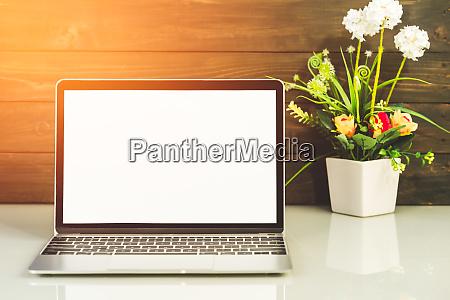 laptop mockup with wood background on