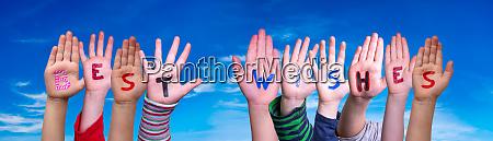 children hands building word best wishes