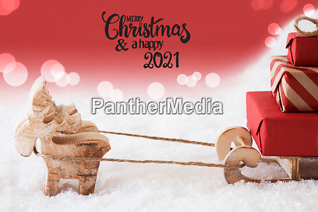 reindeer sled snow red background merry