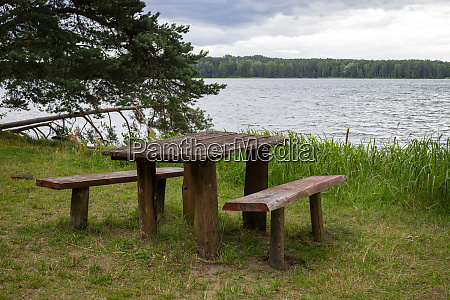 empty rustic wooden table and chairs