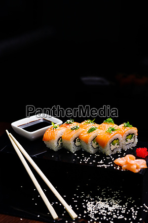 sushi with salmon soy sauce ginger