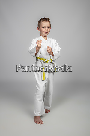 child with judogi in a guard