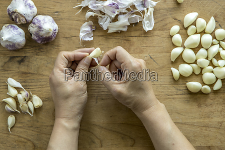peeling a clove of garlic