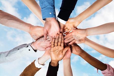 team spirit business huddle people diversity