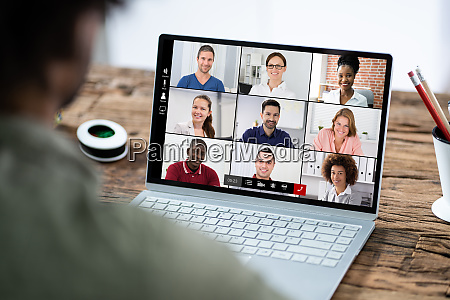 man participating in online coaching session