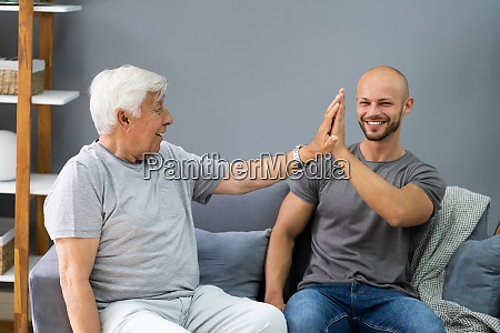 grandpa giving high five to his