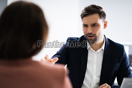 angry employer bullying unhappy stressed employee