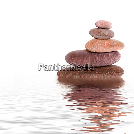 smooth pebble stone cairn on white