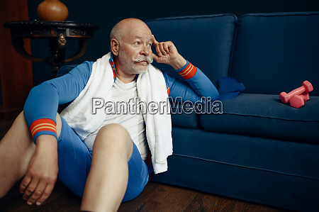 elderly sportsman relaxing after workout at
