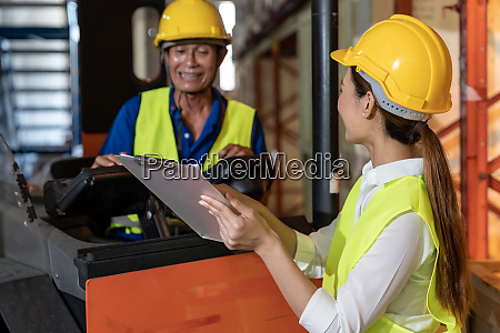 warehouse workers discussion about inventory
