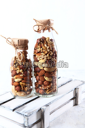 assorted nuts in glass jars two
