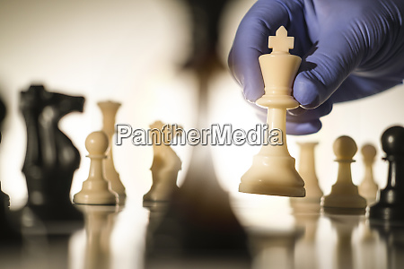 chess king in gloved hand