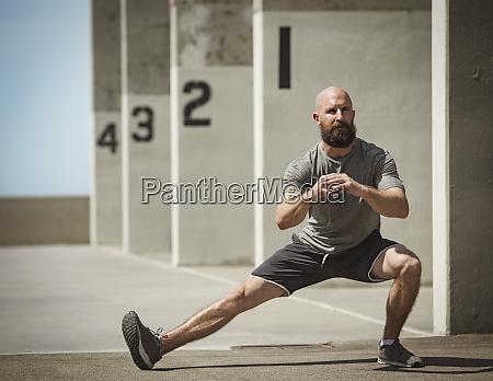 man stretching during training