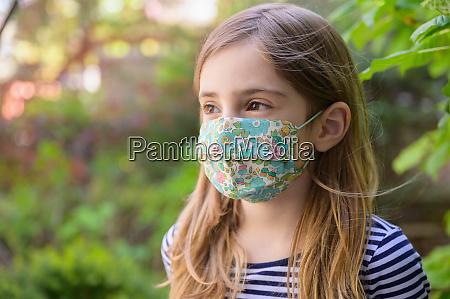girl 6 7 wearing face mask
