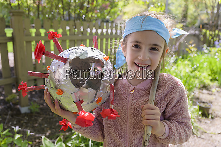 smiling girl 6 7 holding coronavirus