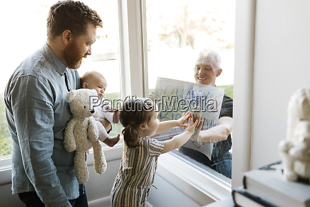 grandfather visiting family with grandchildren 2