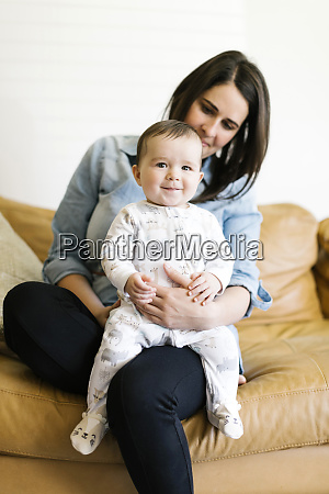 portrait of mother sitting with son