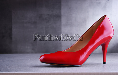 composition with a red high heel
