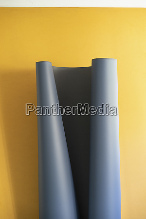 gray sheet unrolling on yellow background