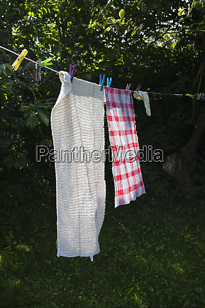 towels drying on sunny clothesline in