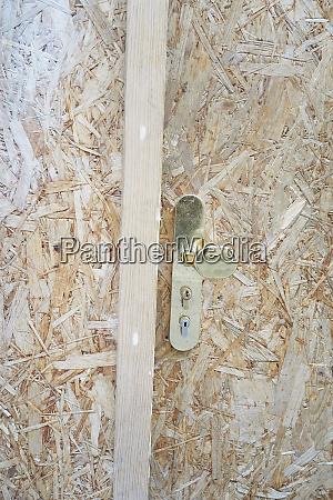 close up fiberboard door handle