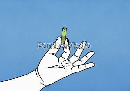 hand holding green battery