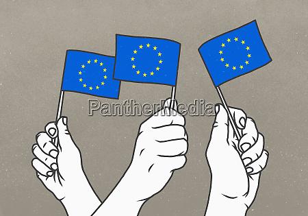 hands waving small european union flags