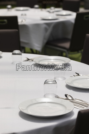 placesettings on round dining tables