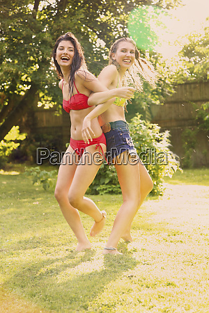 portrait playful teenage girls in bikinis