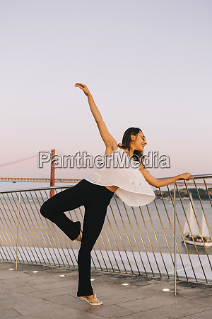 graceful female dancer at waterfront
