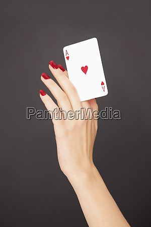 portrait woman with red fingernails holding