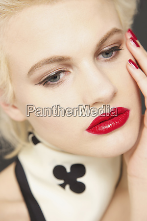 portrait glamorous young woman with red