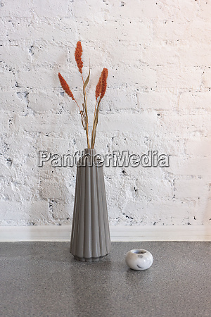 simple modern vase with orange flowers