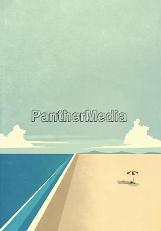 woman sunbathing under umbrella on remote