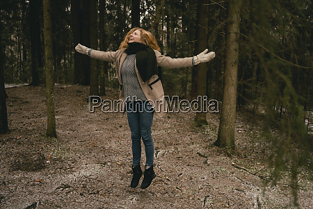 carefree woman jumping for joy in