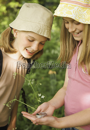 girls with compass exploring