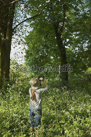 curious girl with binoculars bird watching