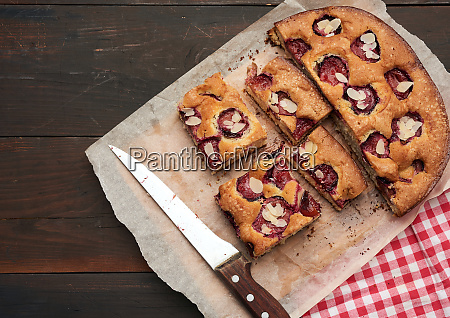 sliced baked pie with plums on