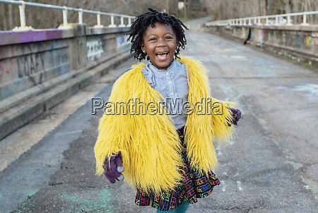 portrait happy girl in yellow fuzzy