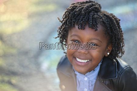 portrait happy girl with curly hair